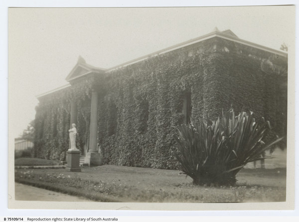 Image: Greek Revival style building covered in ivy