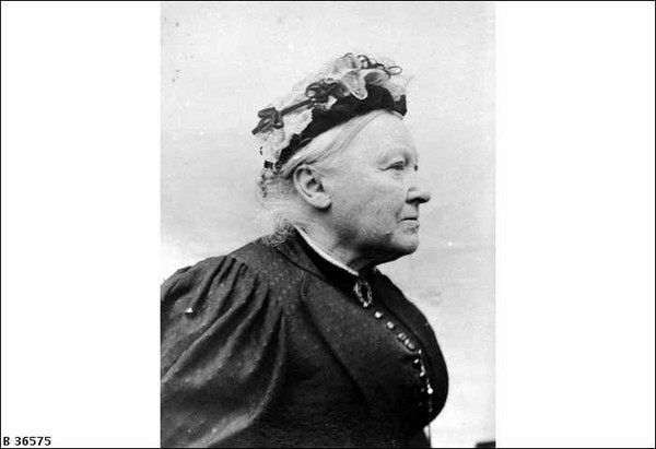 Image: Black and white photograph of elderly woman in profile