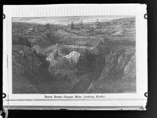 Image: A woodblock print of several buildings and chimneys arrayed at the top of a large open pit