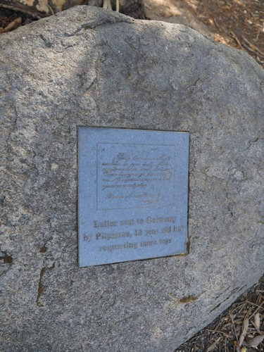Image: bronze engraved plaque set in granite boulder