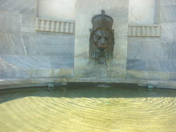 Stone Lions head with water coming out from mouth