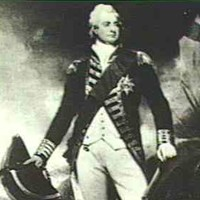 Image: photograph of a man standing amongst rocks and trees wearing a white wig, and a dark military style coat and sash over a cream waistcoat and breeches. He is holding a large hat and sword in one hand and a gun in the other/