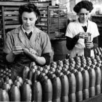 Image: two women looking at bombs