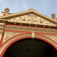 Image: ornate yellow and red archway from early 1900s