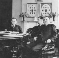 Image: group of men sitting around long table