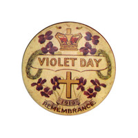 Image: small circular badge with violets, cross and crown pictures