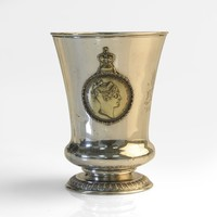 Image: silver cup with image of a woman on side