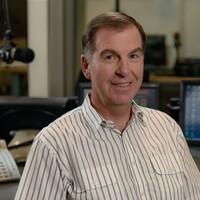 Image: head and shoulder shot of man in radio studio