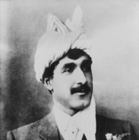 Image: black and white photo of man in suit wearing white turban
