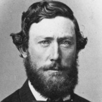 Image: head and shoulders portrait of a man with a beard