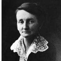 Image: head and shoulders shot of woman looking at camera