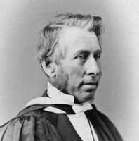 Image: A photographic head-and-shoulders portrait of a middle-aged man with mutton-chop sideburns wearing clerical vestments