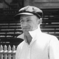 Image: man in cricket whites walking onto oval