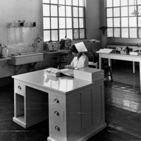 Image: woman in nursing uniform working