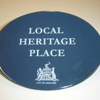 Image: blue plaque with logo and text
