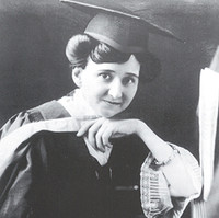 Image: Woman dressed in graduation gown and mortarboard