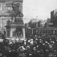 Image: crowds of people around memorial