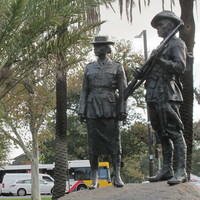 Image: bronze sculpture of man and woman in uniform
