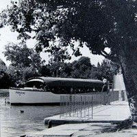 Image: wooden boat with canopy on river