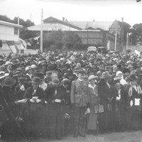 Image: crowds gathering in front of buildings