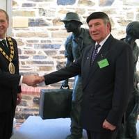 Image: two men shaking hands